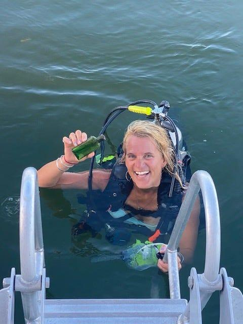 Jennifer Dowker was scuba diving when she spotted a green bottle on top of a fish bed.
