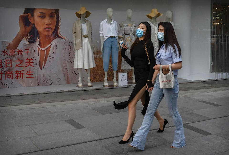 "<h1 class=""title"">Two women in Beijing, China wear masks while shopping earlier this month. Photo by Kevin Frayer/Getty Images.</h1> <div class=""caption""> Two women in Beijing, China wear masks while shopping earlier this month. Photo by Kevin Frayer/Getty Images. </div> <cite class=""credit"">Kevin Frayer</cite>"