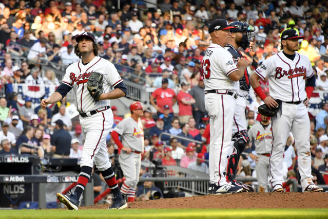 Atlanta Braves pitcher Luke Jackson, left, is relieved with bases loaded in the third inning of Game 5 of their National League Division Series baseball game against the St. Louis Cardinals, Wednesday, Oct. 9, 2019, in Atlanta. (AP Photo/John Amis)