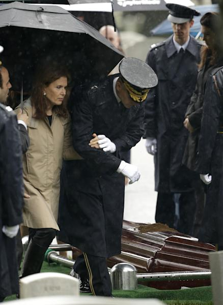 Bonnie Englebardt Lautenberg, left, widow of the late New Jersey Sen. Frank R. Lautenberg is escorted to her seat during burial services at Arlington National in Arlington, Va., Friday, June 7, 2013. Lautenberg, who died Monday at age of 89 after suffering complications from viral pneumonia, was the last World War II veteran in the Senate. (AP Photo/Pablo Martinez Monsivais)