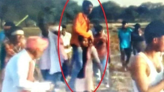 This happened in Devigarh village of MP's Jhabua district. The woman is seen being surrounded by a crowd of tens of people. All of them are men-young, mid-age and the old. They are shouting, some dancing and others hooting at her plight.