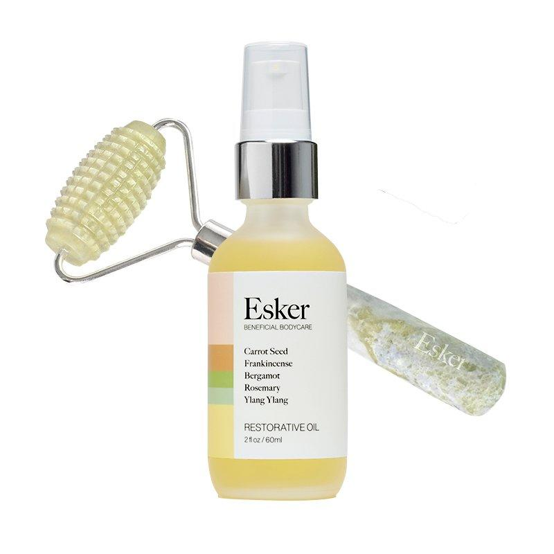 """<p>Post-shower, smooth on the oil, then glide the beveled jade roller over your body to boost circulation and feel like you're getting a massage.</p> <p><strong>To buy:</strong> $98; <a href=""""https://eskerbeauty.com/collections/sets/products/allover-roller-restorative-oil-duo-1"""" target=""""_blank"""">eskerbeauty.com</a>.</p>"""