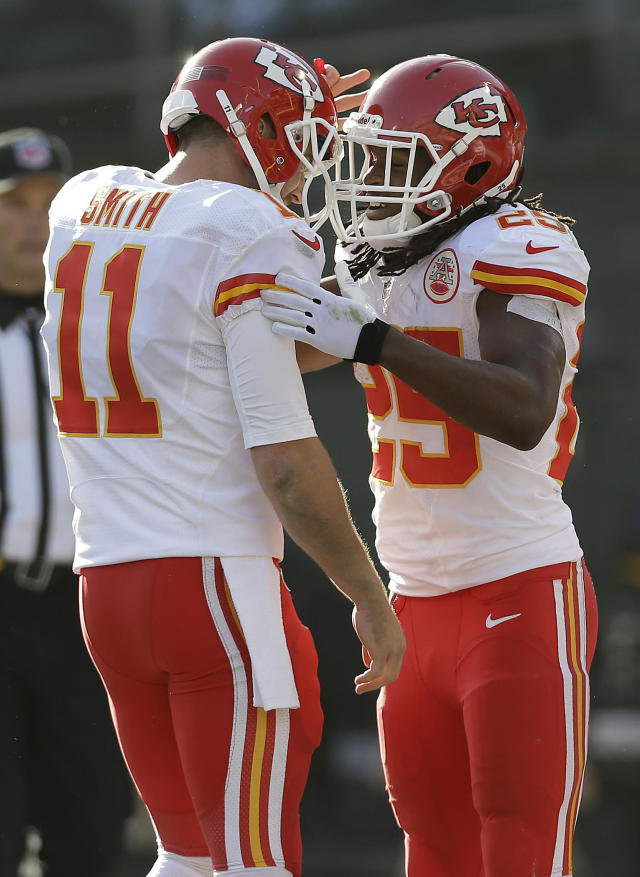 Kansas City Chiefs running back Jamaal Charles, right, celebrates with quarterback Alex Smith (11) after they connected on a 16-yard touchdown pass against the Oakland Raiders during the second quarter of an NFL football game in Oakland, Calif., Sunday, Dec. 15, 2013. (AP Photo/Marcio Jose Sanchez)