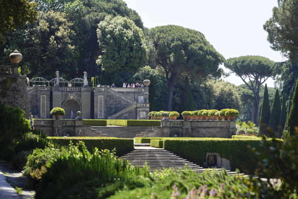 Visitors tour the gardens of the Papal Palace in Castel Gandolfo, some 30 kilometers southeast of Rome, Saturday, May 29, 2021. As Covid-19 restrictions are slowly being lifted in Italy, thousands of people are returning to visit the extensive gardens and apartments at the Papal Palace of Castel Gandolfo in the Alban Hills near Rome, that for hundreds of years have been the summer retreat for Popes seeking to escape the suffocating heat of Rome. (AP Photo/Andrew Medichini)