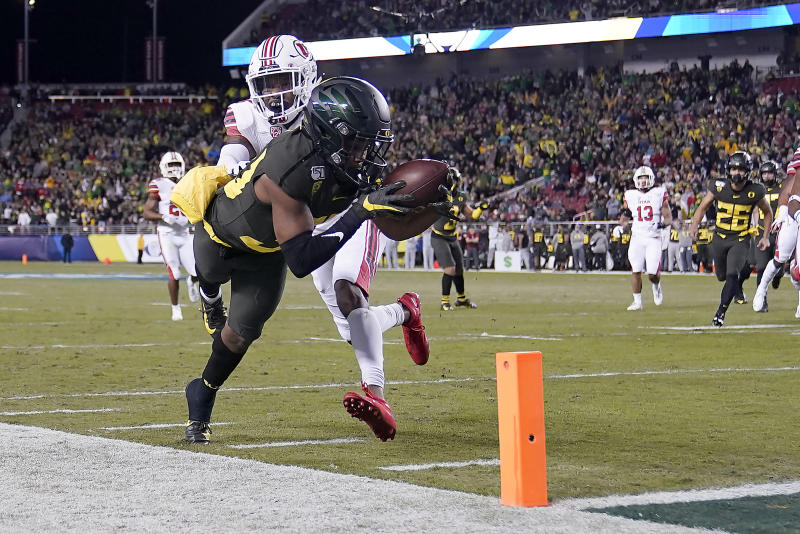Oregon wide receiver Jaylon Redd (30) is pushed out of bounds by Utah defensive back Josh Nurse (14) short of the goal line during the first half of the Pac-12 Conference championship NCAA college football game in Santa Clara, Calif., Friday, Dec. 6, 2018. (AP Photo/Tony Avelar)
