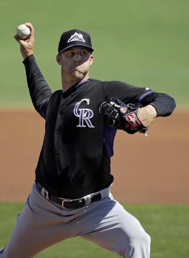 Colorado Rockies starting pitcher Jordan Lyles delivers against the Cleveland Indians in the first inning of a spring exhibition baseball game Saturday, March 22, 2014, in Goodyear, Ariz. (AP Photo/Mark Duncan)