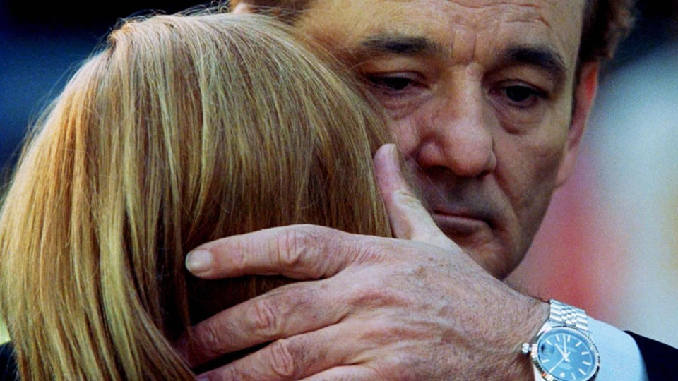 Bill Murray whispers to Scarlett Johansson at the end of 'Lost in Translation'. (Credit: Focus Features)