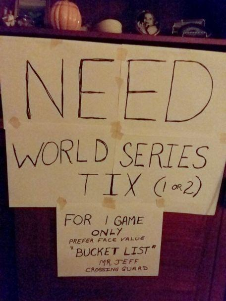 PHOTO: Covel said he and his family are huge Washington Nationals fans, and he held up this sign at his post for a week as a joke, asking for tickets to the big game. (Jeff Covel)