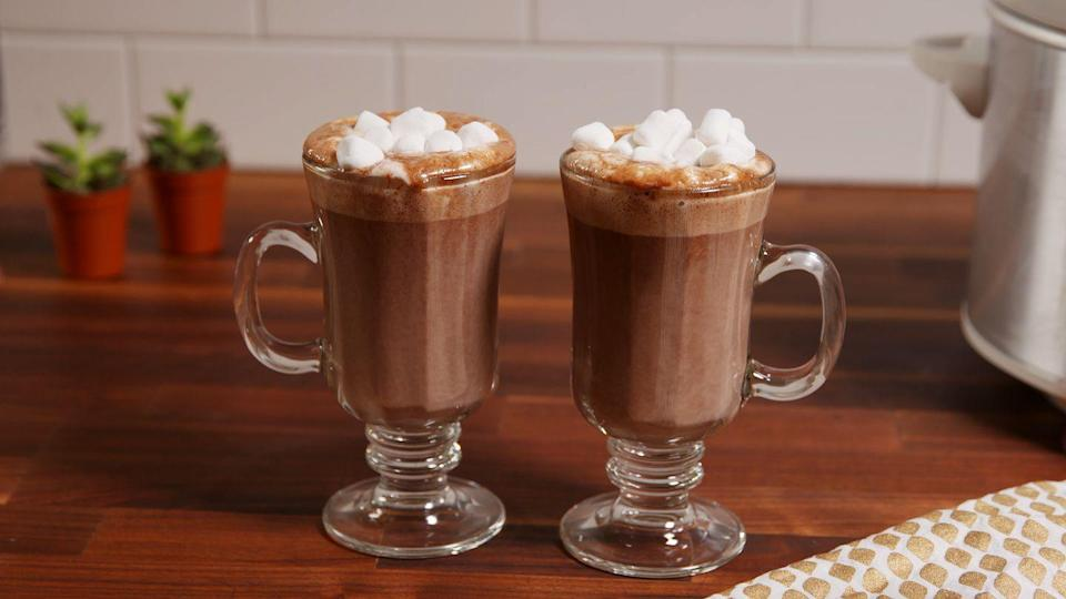 """<p>Marshmallows are optional, hot cocoa is a MUST.</p><p>Get the recipe from <a href=""""https://www.delish.com/cooking/recipe-ideas/recipes/a50816/slow-cooker-hot-chocolate-recipe/"""" rel=""""nofollow noopener"""" target=""""_blank"""" data-ylk=""""slk:Delish"""" class=""""link rapid-noclick-resp"""">Delish</a>.</p>"""