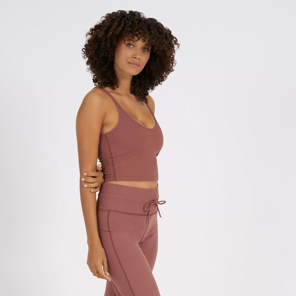 <p>I especially love the <span>Vuori Rib Crop Tank in Dark Cherry</span> ($58) because it comes with a built in bra. I find it supportive enough to wear on its own, without a sports bra for low-impact workouts.</p>