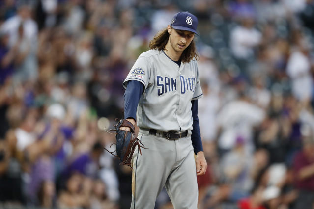 San Diego Padres starting pitcher Matt Strahm reacts after giving up a two-run home run to Colorado Rockies' Trevor Story during the second inning of a baseball game Thursday, June 13, 2019, in Denver. (AP Photo/David Zalubowski)