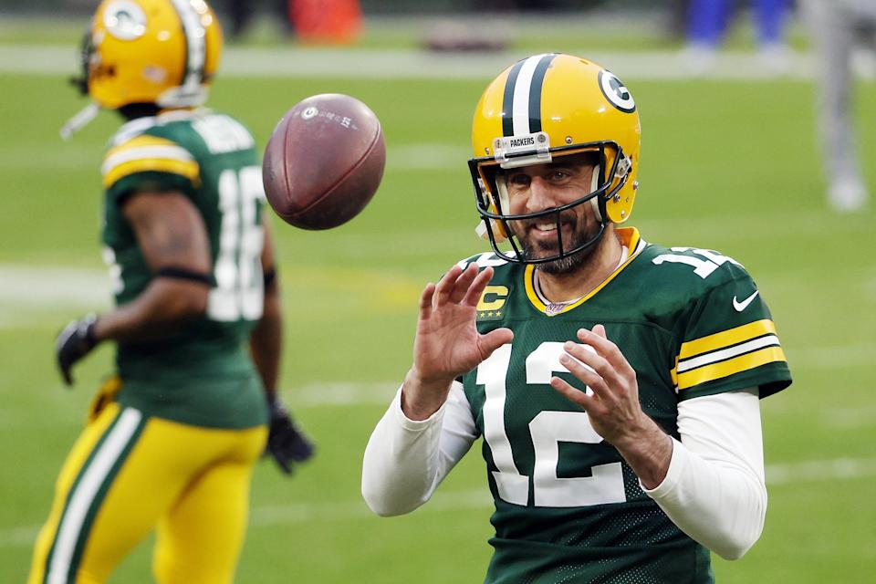 Aaron Rodgers of the Green Bay Packers warms up before the NFC Divisional Playoff game against the Los Angeles Rams at Lambeau Field on January 16, 2021 in Green Bay, Wisconsin.