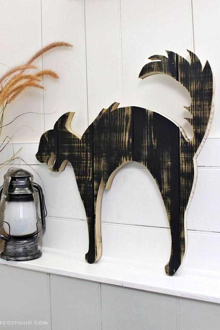 """<p>Delight your houseguests with this cat cutout, which doubles as spooky Halloween décor. A coat of distressed black paint gives the silhouette a rustic, vintage feel.</p><p><strong>Get the tutorial at <a href=""""https://jenwoodhouse.com/diy-halloween-black-cat-wood-cutout/"""" rel=""""nofollow noopener"""" target=""""_blank"""" data-ylk=""""slk:Jen Woodhouse"""" class=""""link rapid-noclick-resp"""">Jen Woodhouse</a>.</strong></p><p><a class=""""link rapid-noclick-resp"""" href=""""https://go.redirectingat.com?id=74968X1596630&url=https%3A%2F%2Fwww.walmart.com%2Fsearch%2F%3Fquery%3Dblack%2Bpaint&sref=https%3A%2F%2Fwww.thepioneerwoman.com%2Fhome-lifestyle%2Fdecorating-ideas%2Fg36732301%2Foutdoor-fall-decorations%2F"""" rel=""""nofollow noopener"""" target=""""_blank"""" data-ylk=""""slk:SHOP BLACK PAINT"""">SHOP BLACK PAINT</a></p>"""
