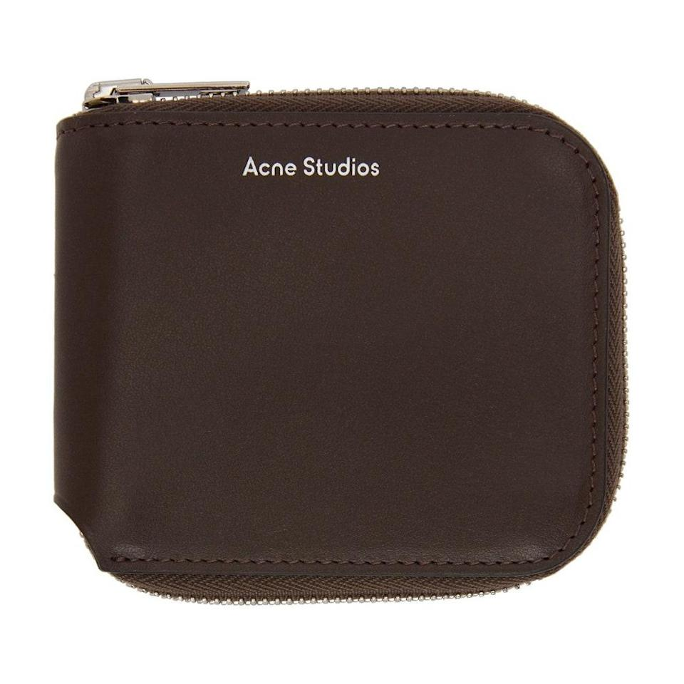 """We're here for the '70s-inspired fixation on all things brown, and this chocolate Acne Studios wallet fits the bill. $220, SSENSE. <a href=""""https://www.ssense.com/en-us/women/product/acne-studios/brown-compact-zip-wallet/6154041"""" rel=""""nofollow noopener"""" target=""""_blank"""" data-ylk=""""slk:Get it now!"""" class=""""link rapid-noclick-resp"""">Get it now!</a>"""