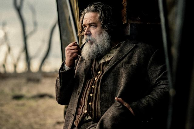 Russell Crowe smokes a pipe as Harry Power in a still from <i>True History of the Kelly Gang</i>. (Picturehouse Entertainment)