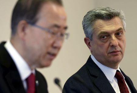 Filippo Grandi listens to Ban Ki-moon during a news conference after the meeting on global responsibility sharing through pathways for admission of Syrian refugees, in Geneva