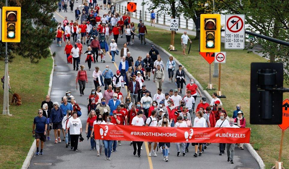 Supporters of Michael Kovrig and Michael Spavor march to mark 1,000 days since the Canadians were arrested in China, during a protest in Ottawa, Ontario, on September 5. Photo: Reuters
