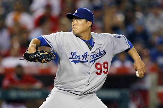 Los Angeles Dodgers starting pitcher Hyun-Jin Ryu, of South Korea, throws against the Los Angeles Angels in the fifth inning of a baseball game Thursday, Aug. 7, 2014, in Anaheim, Calif. (AP Photo/Alex Gallardo)