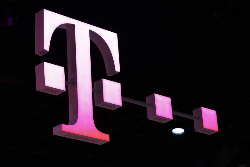 FILE PHOTO: A Deutsche Telekom logo is seen at the Mobile World Congress in Barcelona