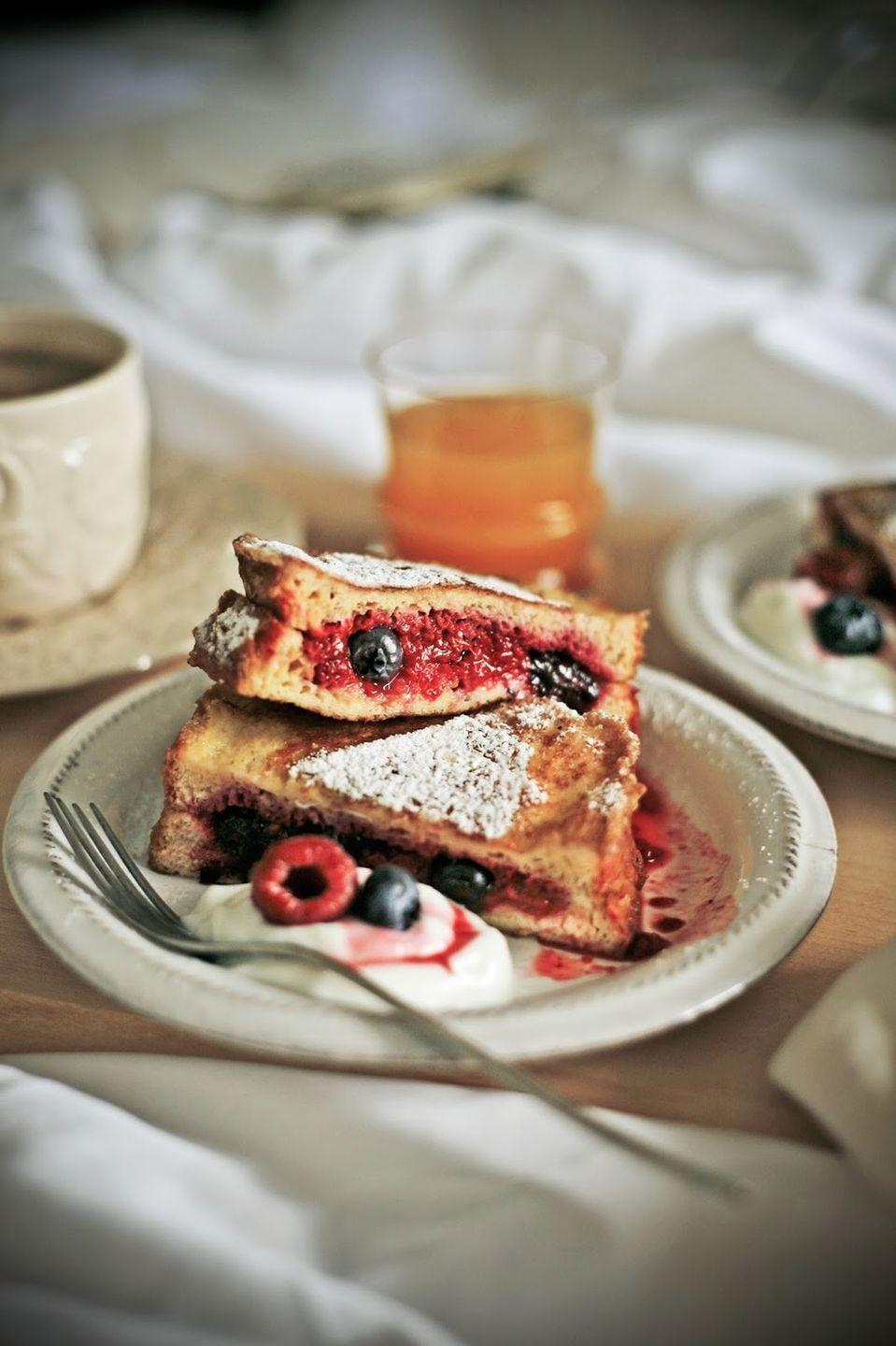 """<p>Fluffy brioche bread gets soaked in an egg and milk mixture, then stuffed with fresh fruit in this tasty breakfast recipe.</p><p><strong>Get the recipe at <a href=""""http://www.ilovewildfox.com/iloveyouwildfox/2015/6/5/brioche-french-toast"""" rel=""""nofollow noopener"""" target=""""_blank"""" data-ylk=""""slk:I Love Inspiration"""" class=""""link rapid-noclick-resp"""">I Love Inspiration</a>.</strong> </p>"""