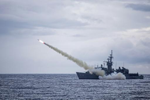 A warship launches a US-made Harpoon missile during the annual drill