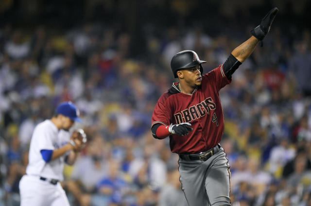 FILE - In this Wednesday, Sept. 6, 2017, file photo, Arizona Diamondbacks' Ketel Marte, right, gestures toward second after scoring on a double by Adam Rosales as Los Angeles Dodgers relief pitcher Luis Avilan walks back to the mound during the seventh inning of a baseball game, in Los Angeles. On Monday, March 26, 2018, a person familiar with the deal says the Arizona Diamondbacks and infielder Marte have agreed to a $24 million, five-year contract. (AP Photo/Mark J. Terrill, File)