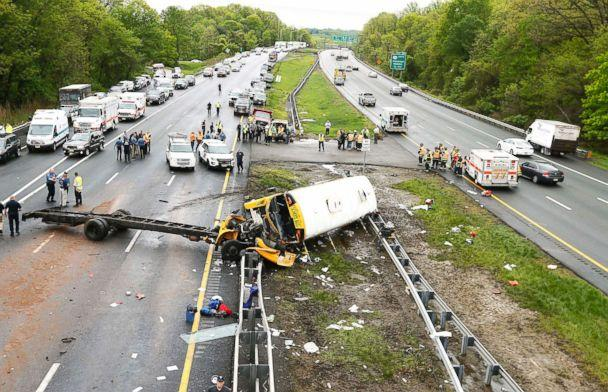 PHOTO: Emergency crews respond to the scene of a crash between school bus carrying middle school students and dump truck on a New Jersey highway, May 17, 2018. (Magdeline Bassett/Asbury Park Press via USA TODAY NETWORK)