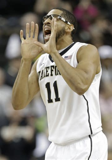 Wake Forest's C.J. Harris (11) shouts to teammates after making a basket against Miami during the first half of an NCAA college basketball game in Winston-Salem, N.C., Saturday, Feb. 23, 2013. (AP Photo/Chuck Burton)