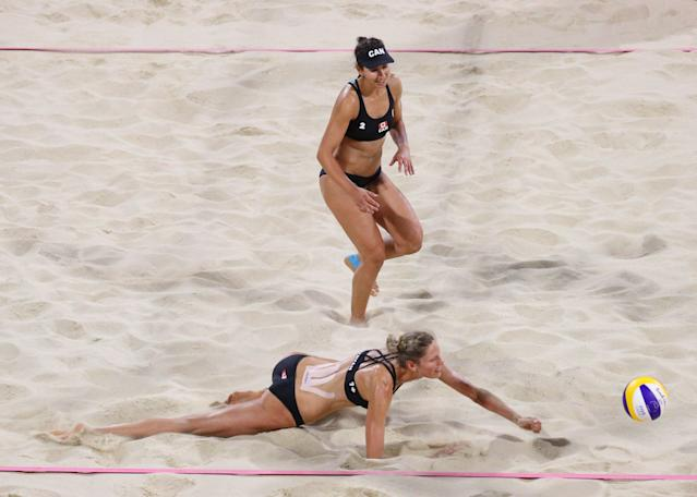 Beach Volleyball - Gold Coast 2018 Commonwealth Games - Women's Gold Medal Match - Australia v Canada - Coolangatta Beachfront - Gold Coast, Australia - April 12, 2018. Sarah Pavon and Melissa Humana-Paredes of Canada in action. REUTERS/Athit Perawongmetha