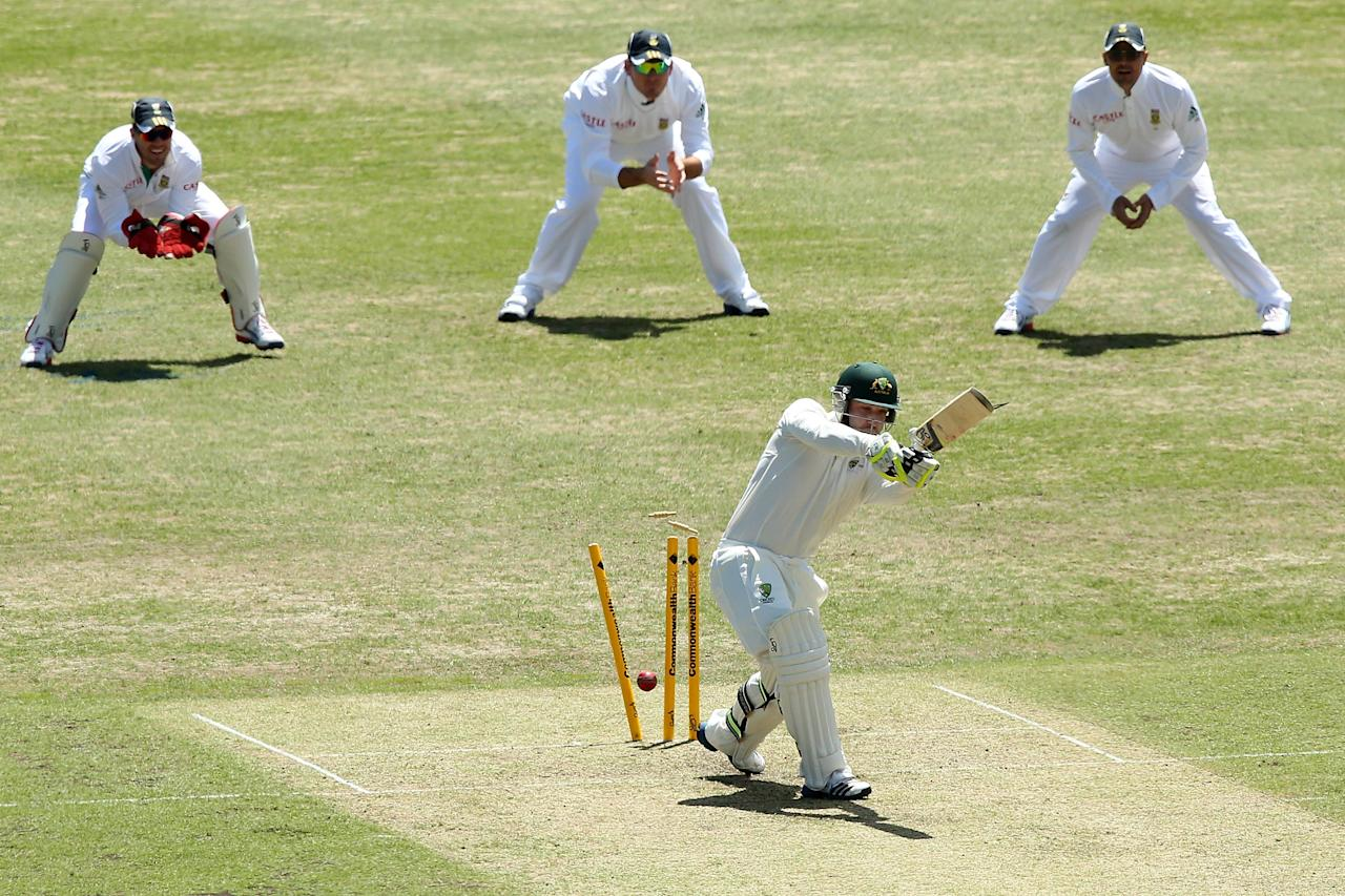 SYDNEY, AUSTRALIA - NOVEMBER 02:  Phillip Hughes of Australia A is bowled by Rory Kleinveldt of South Africa during day one of the International tour match between Australia A and South Africa at Sydney Cricket Ground on November 2, 2012 in Sydney, Australia.  (Photo by Chris Hyde/Getty Images)