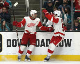 Detroit Red Wings center Andreas Athanasiou (72) celebrates with Frans Nielsen, right, after scoring a goal against the San Jose Sharks during the second period of an NHL hockey game Monday, March 25, 2019, in San Jose, Calif. (AP Photo/Tony Avelar)