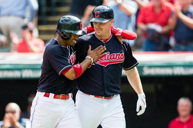 Francisco Lindor (L) celebrates with Jay Bruce of the Cleveland Indians after both scored during the first inning on a home run by Bruce at Progressive Field on September 13, 2017 in Cleveland, Ohio