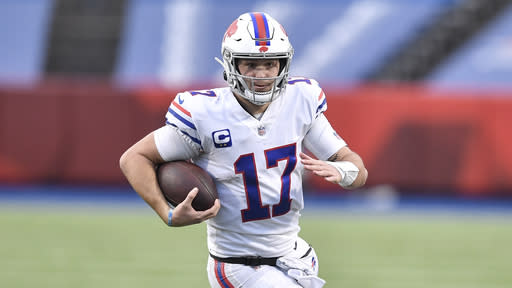Buffalo Bills quarterback Josh Allen runs the ball during the second half of an NFL football game against the Los Angeles Chargers, Sunday, Nov. 29, 2020, in Orchard Park, N.Y. (AP Photo/Adrian Kraus)