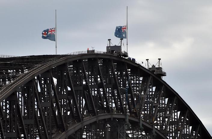 Australian flags fly at half mast on Sydney Harbour bridge following the fatal cafe siege in the heart of Sydney's financial district on December 16, 2014 (AFP Photo/Peter Parks)
