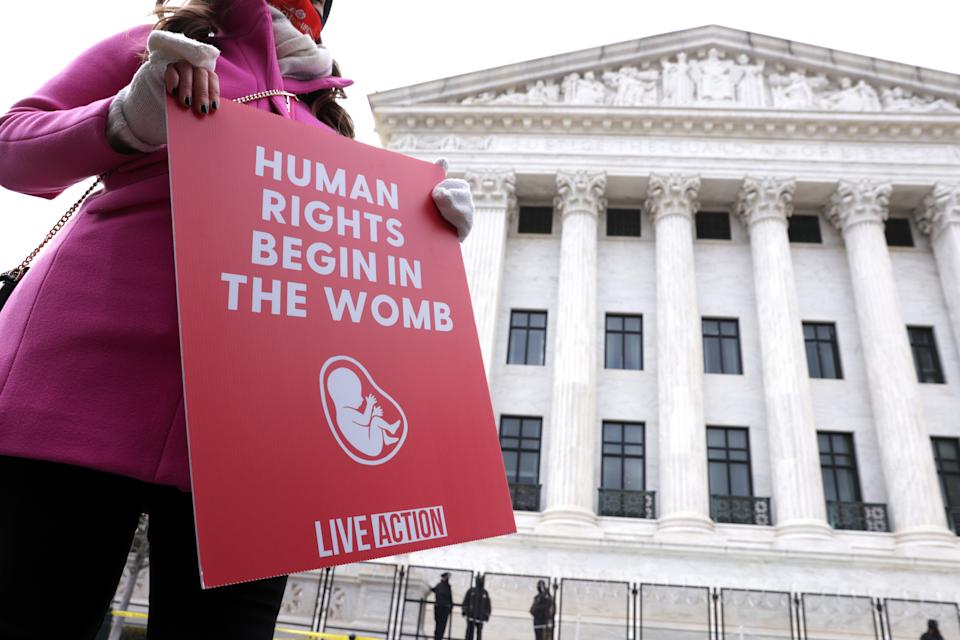 An anti-abortion activist holds a sign outside the U.S. Supreme Court during the 48th annual March for Life January 29, 2021 in Washington, DC. (Alex Wong/Getty Images)