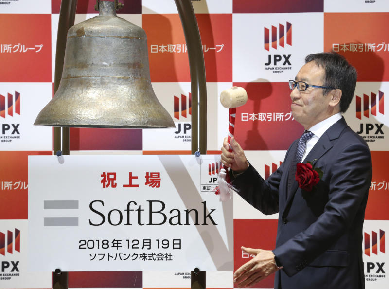 SoftBank Corp.'s CEO Ken Miyauchi rings the bell during a ceremony at the Tokyo Stock Exchange in Tokyo Wednesday, Dec. 19, 2018. SoftBank Group Corp.'s Japanese mobile subsidiary began trading on the Tokyo Stock Exchange on Wednesday in one of the world's biggest share offerings.(AP Photo/Koji Sasahara)