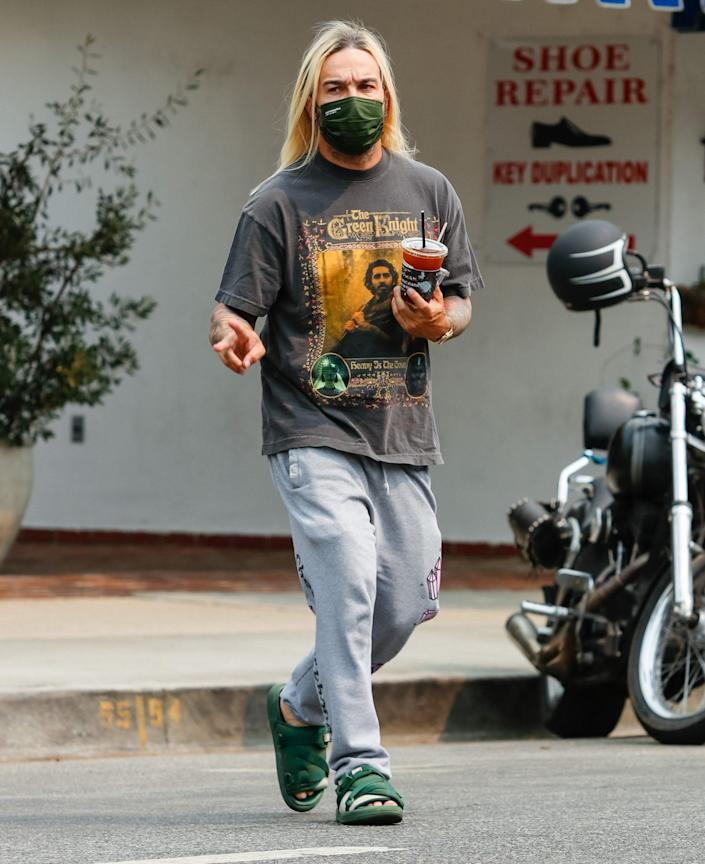 <p>Pete Wentz shows off his long blond locks during a coffee run in Los Angeles on Sept. 24. </p>