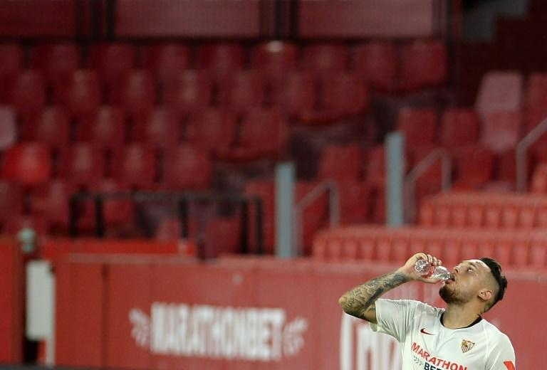 Thirsty work: Sevilla's Argentinian midfielder Lucas Ocampos drinks water during the game with Mallorca