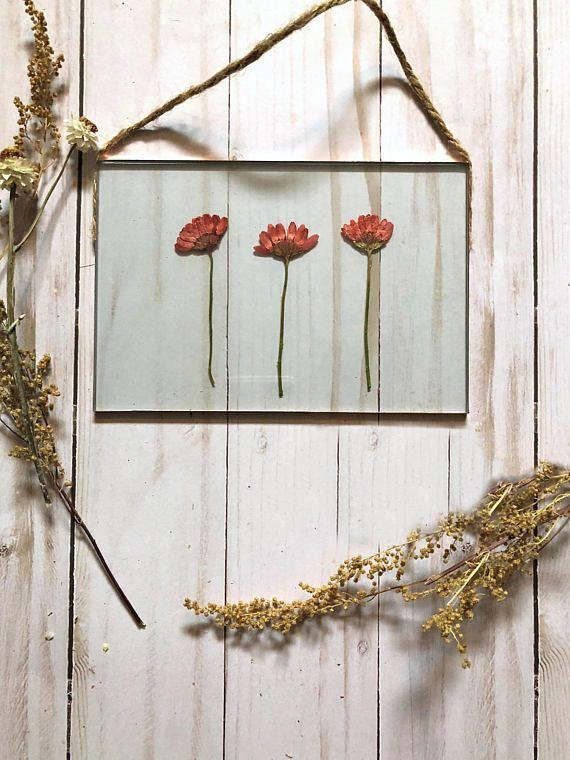 "Get it from <a href=""https://www.etsy.com/listing/498613680/real-pressed-flower-floating-frame-glass?ga_order=most_relevant&ga_search_type=all&ga_view_type=gallery&ga_search_query=real%20pressed%20flower%20wall%20hanging&ref=sr_gallery-1-5"" target=""_blank"">The Flower Sundry on Etsy, $35</a>."