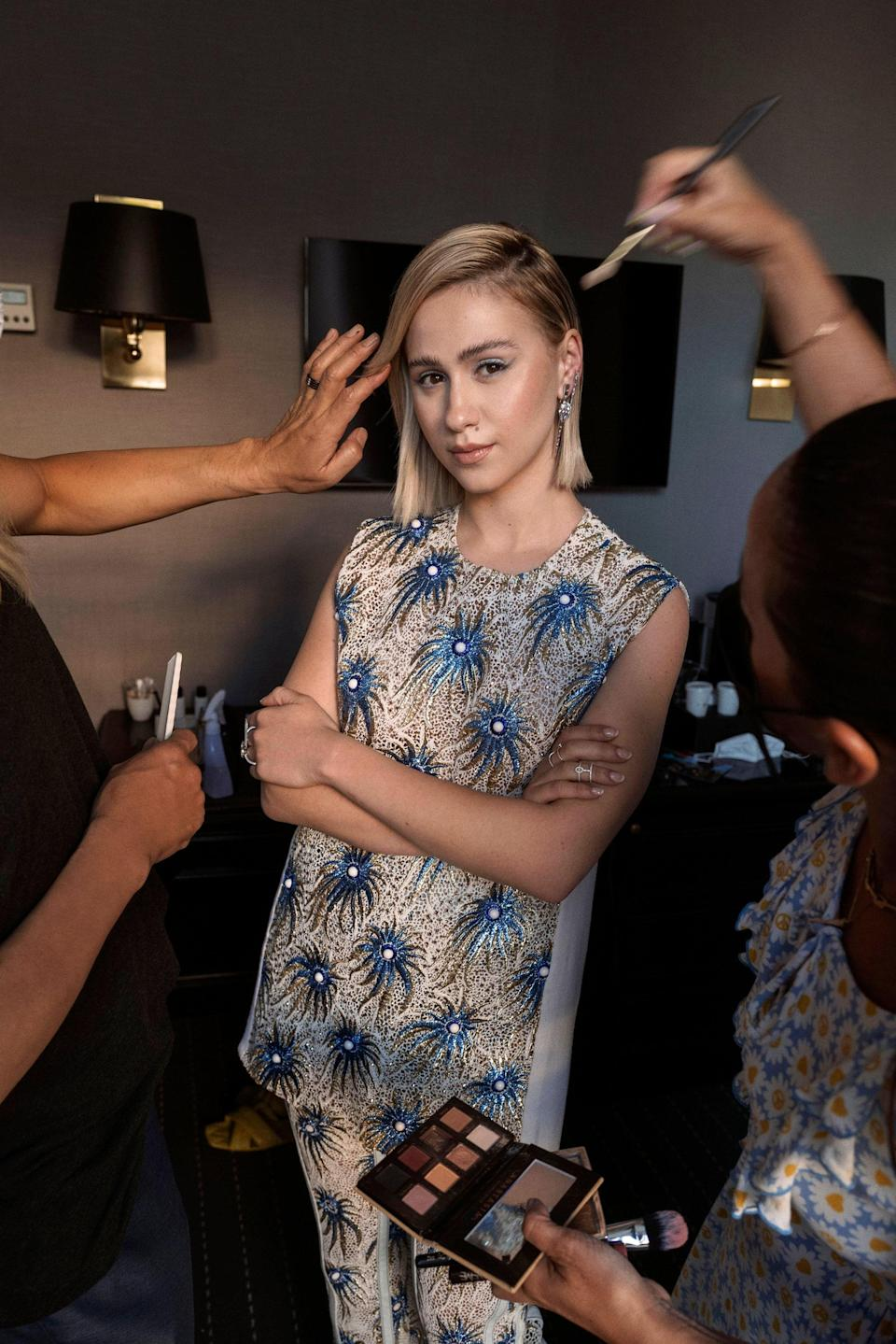 Bakalova gets ready for the red carpet for Titane in her Louis Vuitton fall 2021 look.