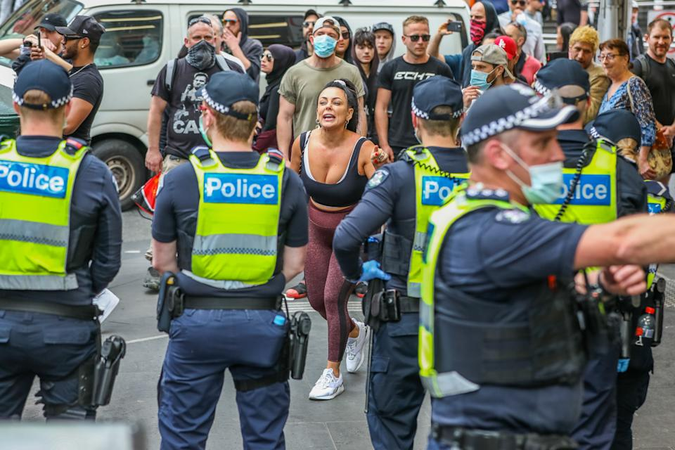 Protesters shout at police officers as violent clashes took place in Melbourne on Saturday as anger over lockdowns continues to bubble over. Source: Getty