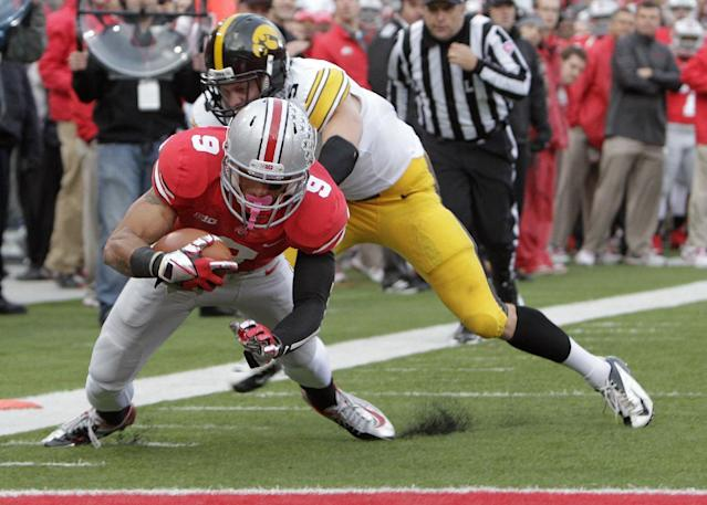 Ohio State wide receiver Devin Smith, front, scores a touchdown as Iowa defensive back Tanner Miller tries to stop him during the third quarter of an NCAA college football game Saturday, Oct. 19, 2013, in Columbus, Ohio. Ohio State beat Iowa 34-24. (AP Photo/Jay LaPrete)