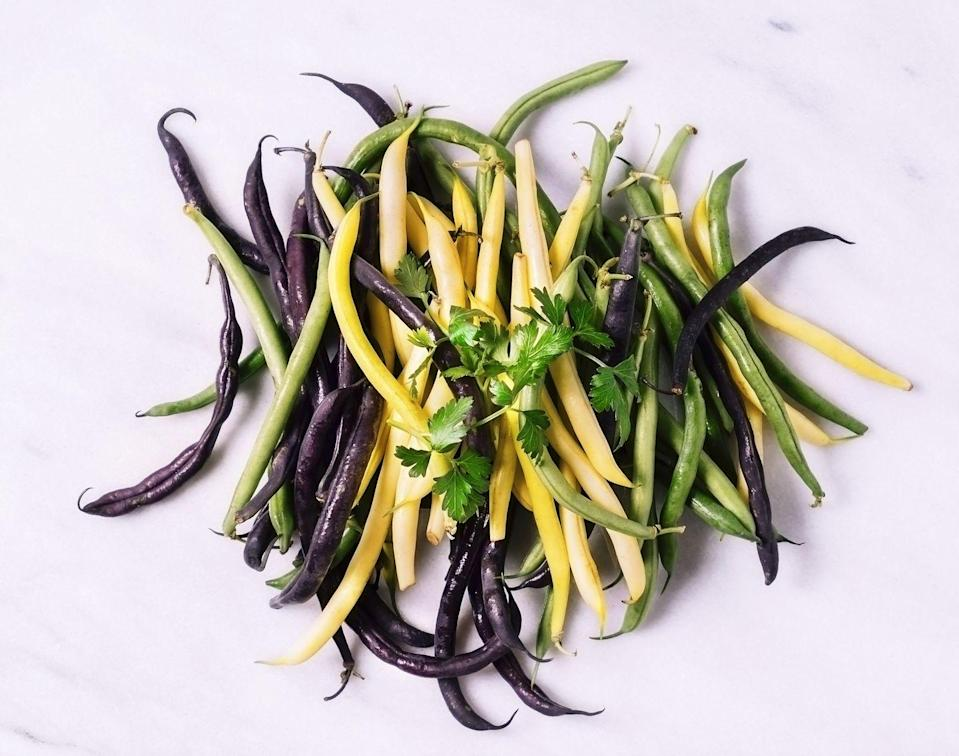 """<p>While we sourced three different varieties here, plain ole' green beans are just fine. In a pinch, caramelizing them in a hot sheet pan with garlic and Parmesan cheese is the way to go: you can have them ready to eat in 20 minutes flat.<br></p><p><a href=""""https://www.goodhousekeeping.com/food-recipes/a29772262/keto-garlicky-green-beans-recipe/"""" rel=""""nofollow noopener"""" target=""""_blank"""" data-ylk=""""slk:Get the recipe for Garlicky Green Beans »"""" class=""""link rapid-noclick-resp""""><em><em>Get the recipe for Garlicky Green Beans <em><em>»</em></em></em></em></a></p>"""