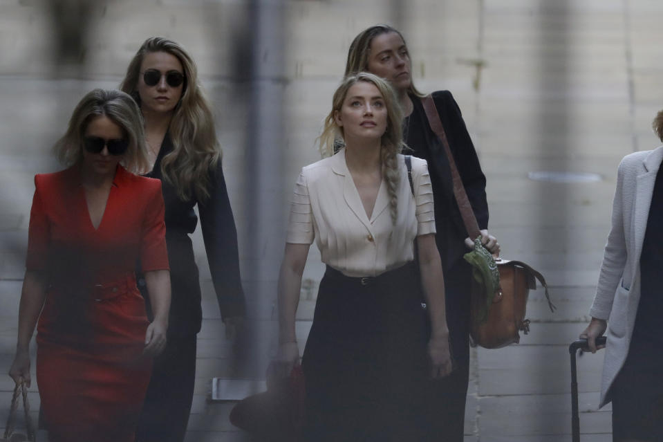 Actress Amber Heard arrives at the High Court in London, Monday, July 20, 2020. Amber Heard started Monday to give evidence at the High Court in London as part of Johnny Depp's libel case against The Sun over allegations of domestic violence during the couple's relationship. (AP Photo/Matt Dunham)