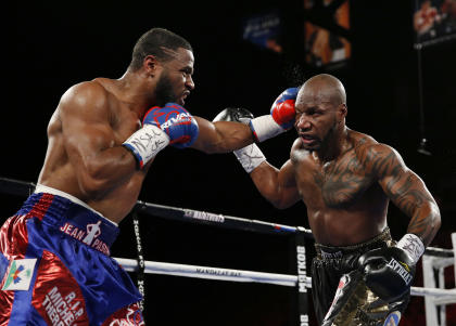 Jean Pascal hits Yunieski Gonzalez during their light heavyweight boxing bout in July 2015. (AP)