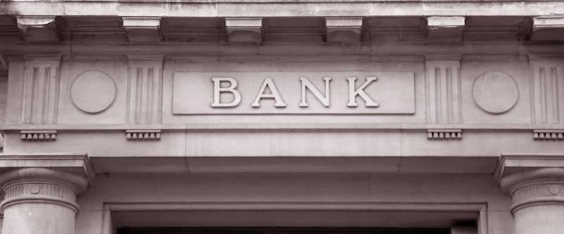 Bank Sign over Entrance Door in Black and White Sepia Tone