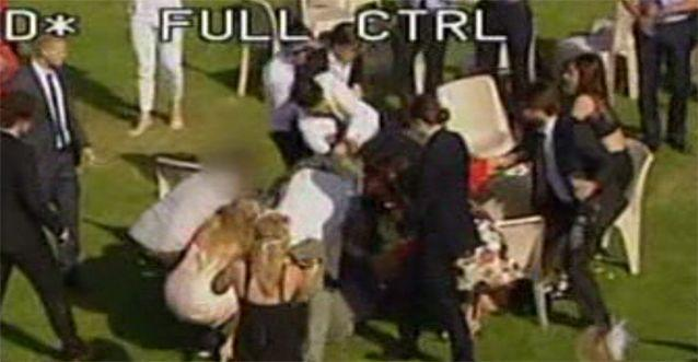 Chairs fly, women are left scrambling in the wake of the fight. Photo: 7News