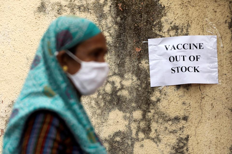 A notice about the shortage of coronavirus disease (COVID-19) vaccine supplies is seen at a vaccination centre, in Mumbai, India, April 8, 2021. (Francis Mascarenhas/Reuters)