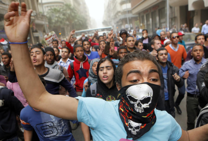 Egyptians shout anti-Muslim Brotherhood slogans during a march to the Brotherhood headquarters in Cairo, Egypt, Friday, March 22, 2013. Thousands of protesters from different areas of Cairo marched on Friday to express their rejection of the Muslim Brotherhood and President Mohammed Morsi's rule. (AP Photo/Amr Nabil)