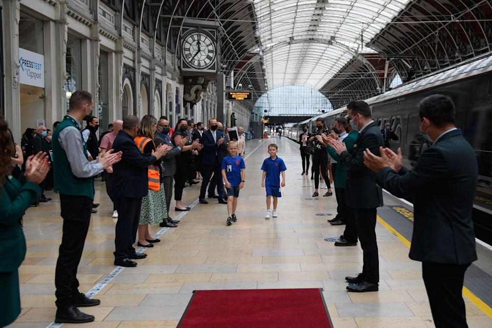Henry and fellow fundraiser Lincoln are applauded by GWR staff.